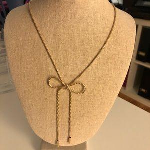Long bow pendant necklace